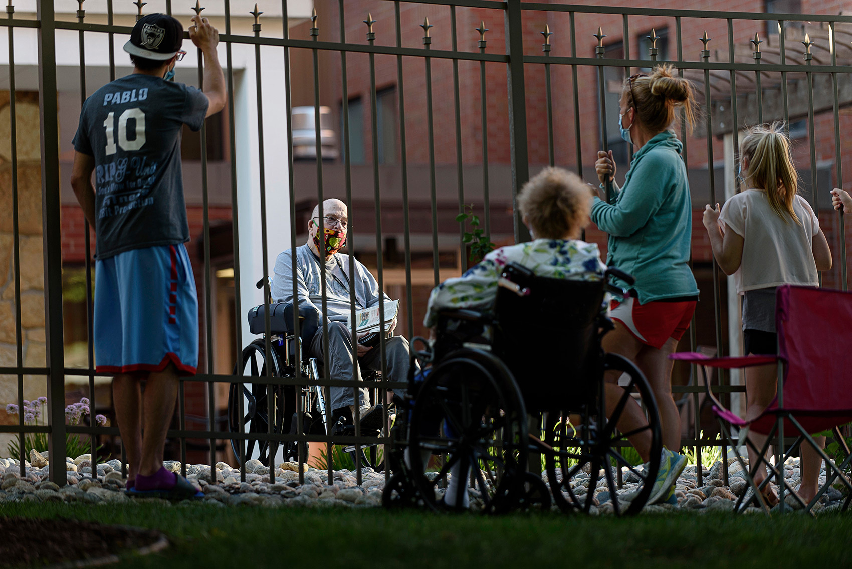 Photo of relatives visiting a nursing home resident taken by Fargo, North Dakota photojournalist Dan Koeck.