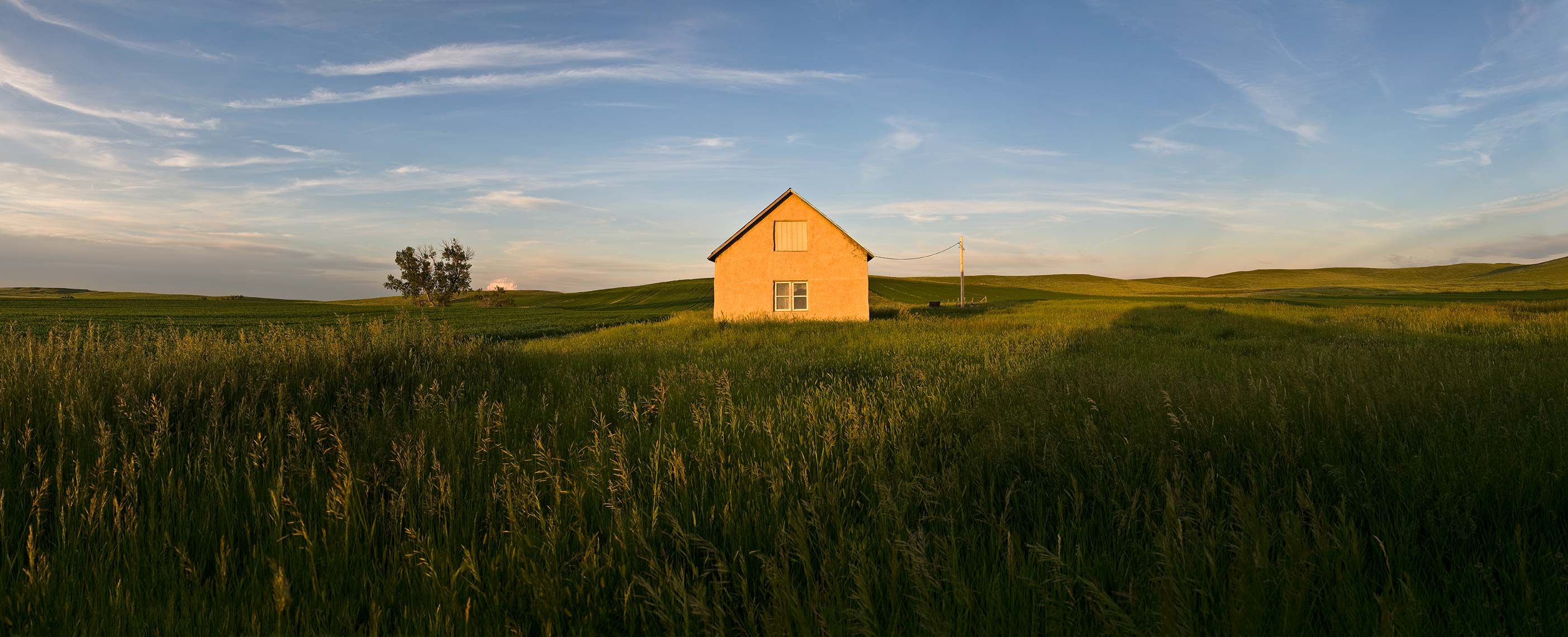 Abandoned farmhouse on western North Dakota prairie.